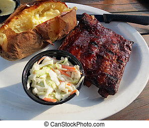 Sparerib Dinner - Barbequed spareribs served with a baked...