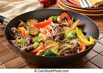Stir fry in a wok - A healthy stir fry in a wok with serving...