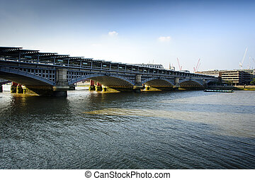 Blackfriars Bridge London - Golden sunlight catches part of...