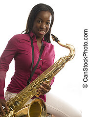 young african american girl playing saxophone music - young...