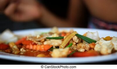 Time lapse speed up Close up of woman hand eats stir fried...