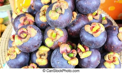 Close up of asian fruits mangosteen, grape on a market. HD....