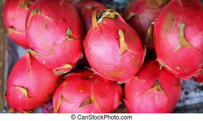 Close up of asian fruits dragon fruit, banana on a market....