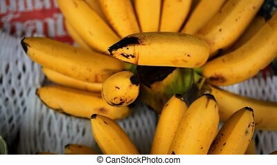 Close up of asian fruits banana on a market. HD. 1920x1080 -...