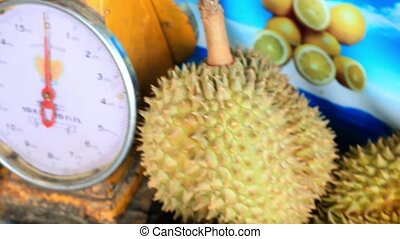 Close up of scales and asian fruits durian, banana, rambutan...