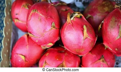 Close up of asian fruits dragon fruit on a market. HD....