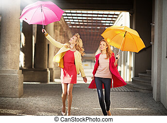 Two attractive blonde ladies during spring walking - Two...