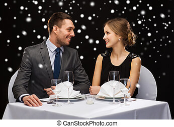 smiling couple at restaurant