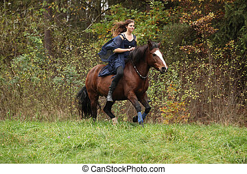 Amazing girl with horse running without bridle and saddle in...