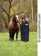 Pretty woman with pony - NHS - Pretty woman with pony in...