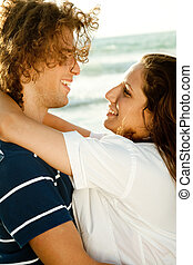 Young couple filled with joy - Man and woman enjoying...