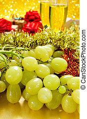 grapes, champagne and gifts - closeup of a bunch of grapes...