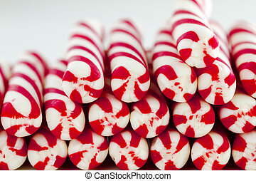 Christmas Candy Canes and Peppermint Sticks - Close up of...