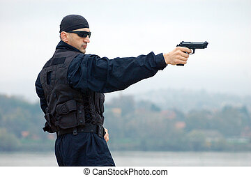 security man - The security man is shooting with gun.