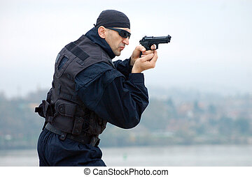 security man - The security man is shooting with gun