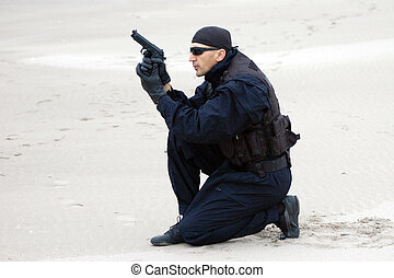 security man - The security man with gun is in desert