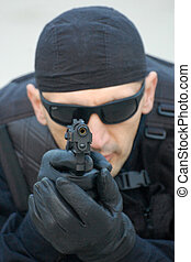 security man - The security man aim at us with gun.