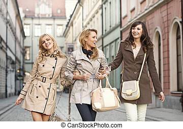 Group of girlfriends walking in the old town - Group of...