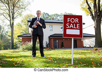Real estate agent in work - Young and handsome real estate...