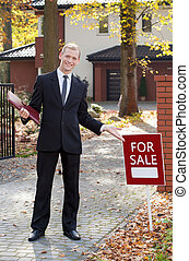 Smiling real estate broker