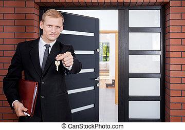 Standing in front of door - House agent standing in front of...