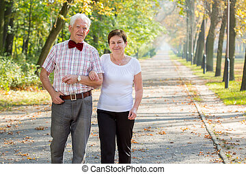 Man and his happy woman - Elderly man and his happy beloved...