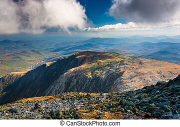 View of the rocky, rugged White Mountains from the summit of...