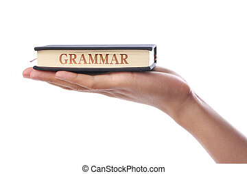 Grammar Book - Hand with Grammar Book isolated on white...