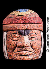 Olmec culture - a terracotta olmec face idol souvenir...