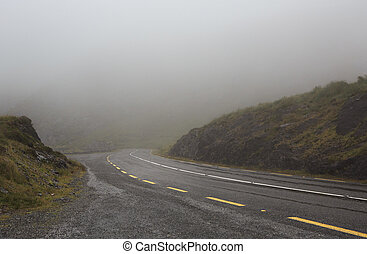 Mountain road in the fog Ring of Kerry in Ireland