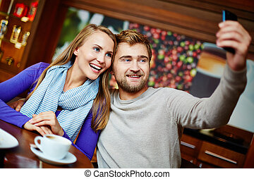Dating - Happy dates taking their selfie on cellular phone