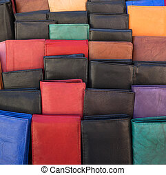 Wallets - Numerous leather wallets in different colors were...