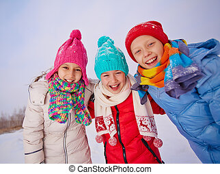 Friends in winterwear - Group of ecstatic children in...