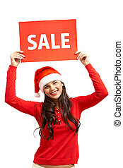 Welcome to Christmas sale - Happy girl in Santa cap showing...