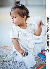 Playing with pencils - Portrait of adorable little girl with...