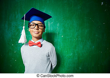 Intelligent graduate - Elementary learner in eyeglasses and...