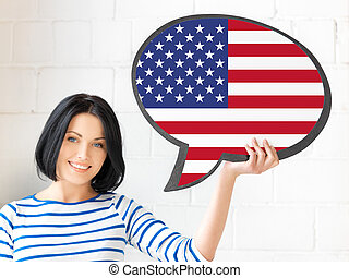 smiling woman with text bubble of american flag - education,...