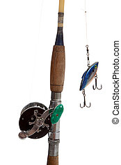 A fishing rod, reel and lure on a white background - A...