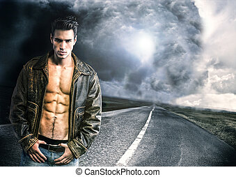 Young man walking down a road with a storm and very bad...