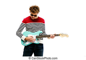 Handsome man in sunglasses playing on the guitar