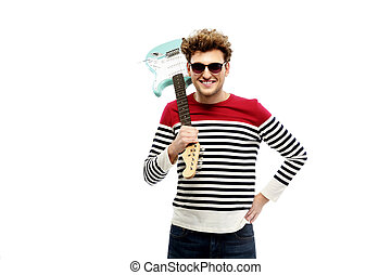 Happy man in sunglasses holding guitar on a white background