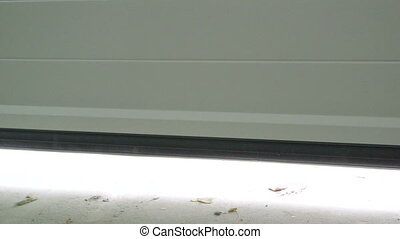 Sectional automatic garage door opening view from inside