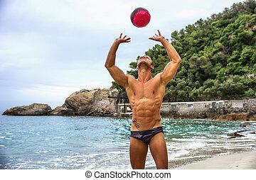 Muscular young man with volleyball playing volley - Muscular...