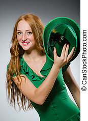Young woman wearing green dress