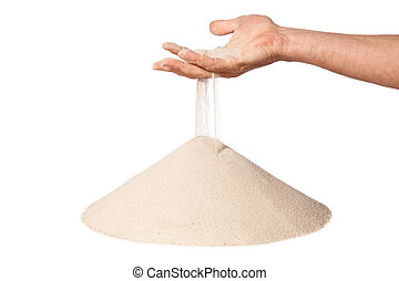 hand with falling sand on pile