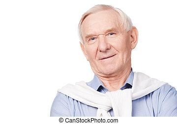 Confident senior man. Portrait of senior man smiling at...