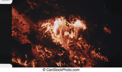 Lava flow (1970s film footage) - Lava flowing at night...