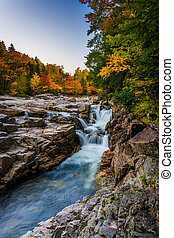 Autumn color and waterfall at Rocky Gorge, on the Kancamagus...