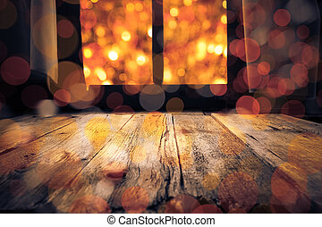 Old rural interior: window table overlooking blurry lights -...