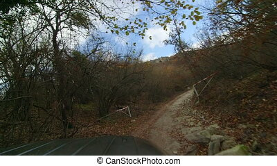 SUV driving through stony section of trail in the Crimean...